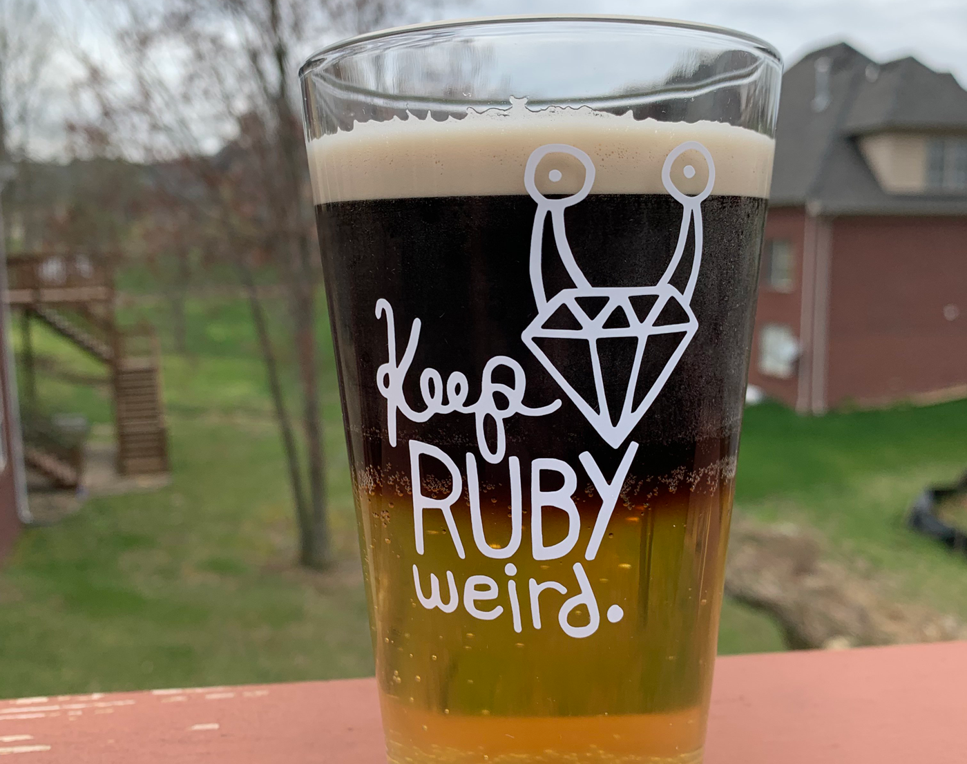 Keep Ruby Weird logo on a glass full of beer
