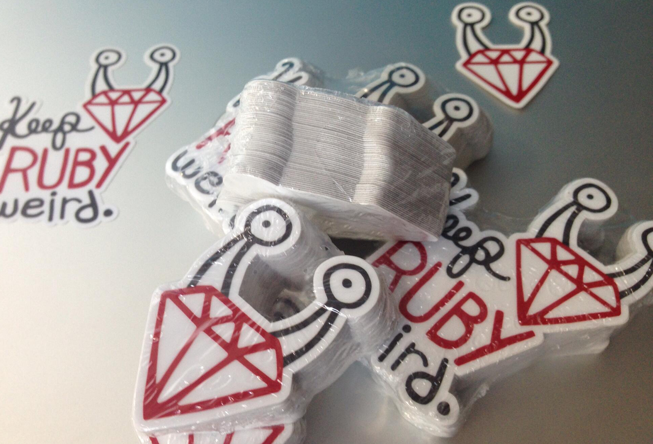 A pile of Keep Ruby Weird stickers